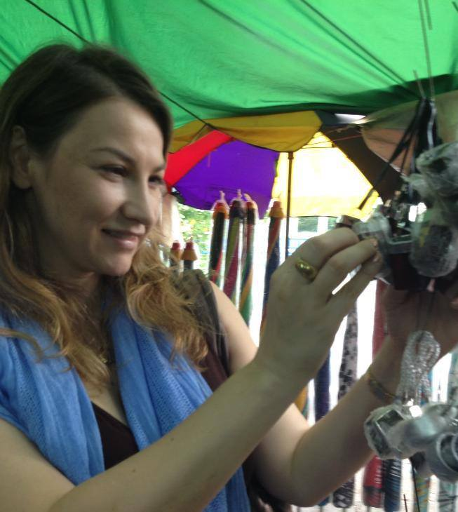 Paul's Antiques Owner, Angela Somwaiya, hunting treasures at Scott's Market, Yangon, Myanmar