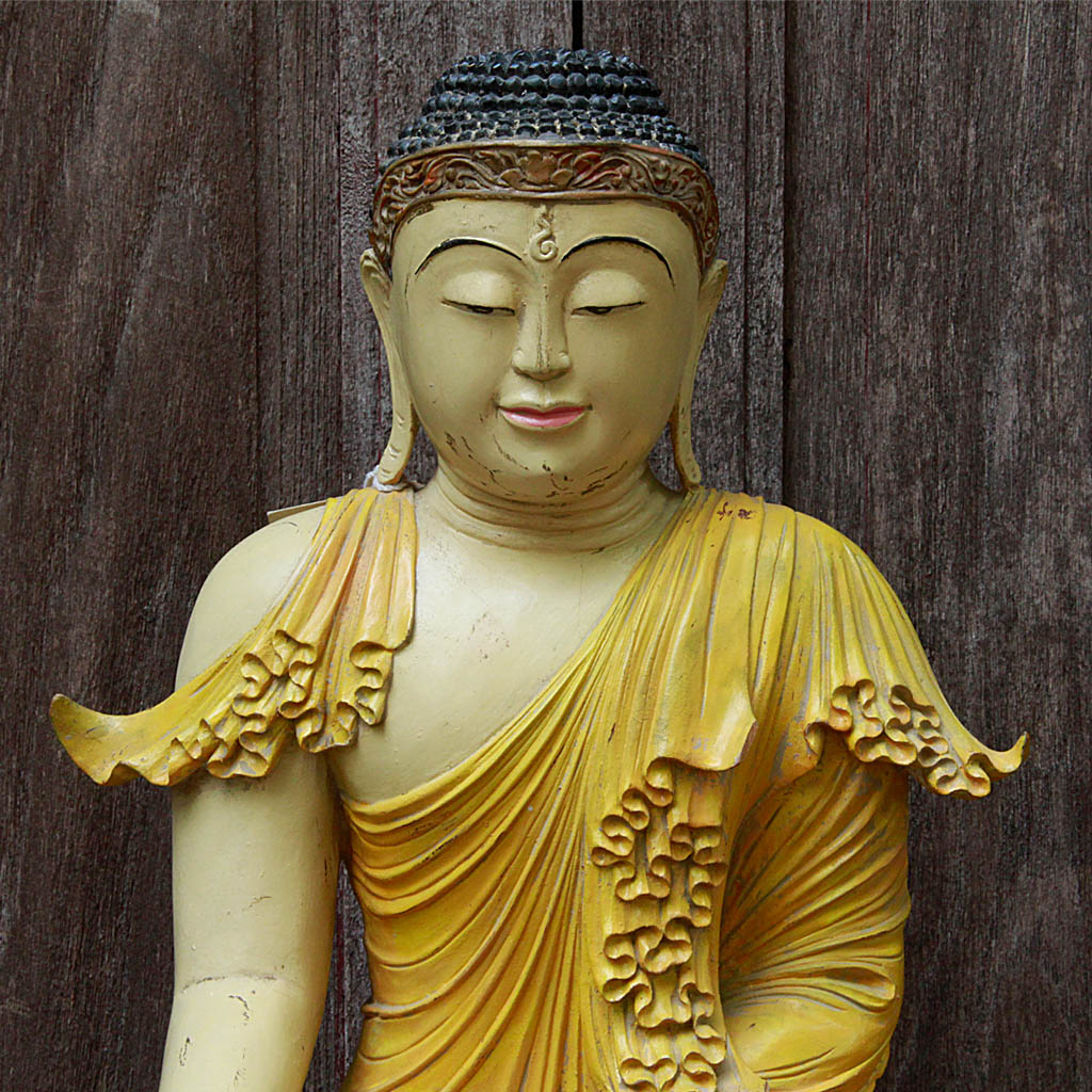 Burmese Buddha Sitting In Bhumisparsha In Stylized Yellow Robes Atop