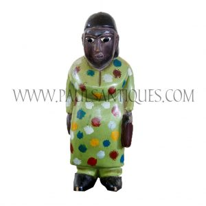 Côte d'Ivoire African Wooden Female Colon Statue in Green Polka Dot Dress Holding Satchel